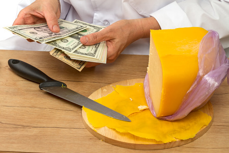 Hands Seller cheese counts USD cash