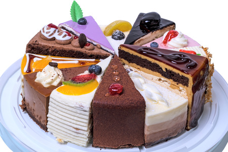 Twelve different pieces of cake. Isolated on white background Stock Photo - 63497785