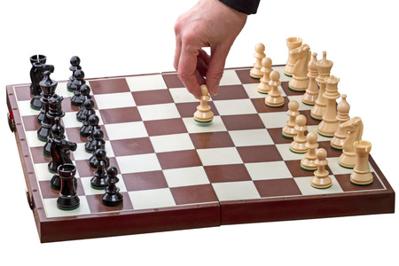 first move: Hand makes the first move a pawn isolated on white background