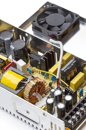 radio unit: Switching power supply with the lid open on a white background Stock Photo