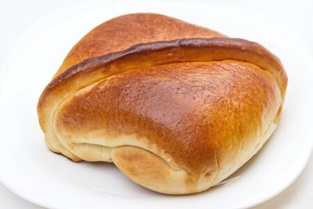Simple delicious bun on a white plate Stock Photo