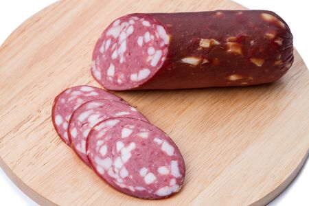 smoked sausage: Smoked sausage on a kitchen board.  Isolated on white background