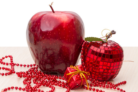 full length mirror: Red apple and the glass of Christmas toys Stock Photo