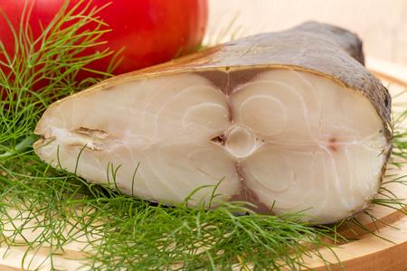 finocchio: Cold smoked fish on a kitchen board