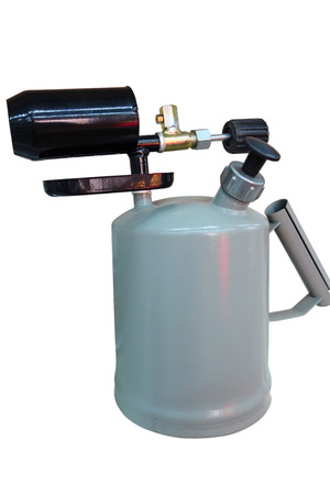 A blowtorch  or blowlamp, is a fuel-burning tool used for applying flame and heat to various applications. Liquid-fuelled torches are pressurized by a piston hand pump Stock Photo