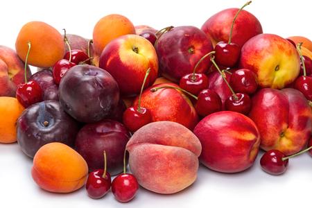 Heap different fruits: cherry, peach, nectarine, apricot, plum