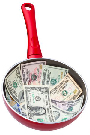 Dollar banknotes in a frying pan. Isolated on white background Stock Photo