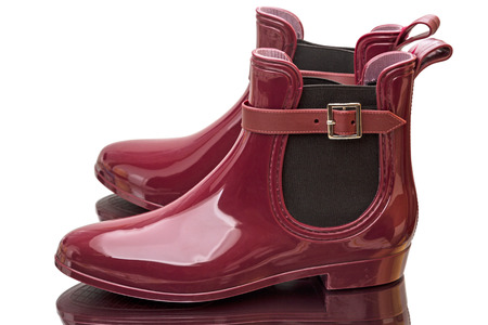 Female claret rubber boots isolated on white background