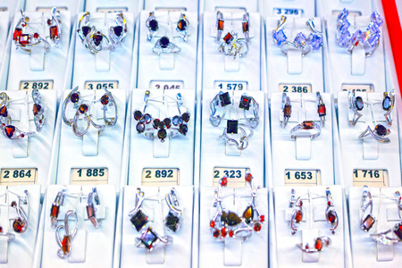 Showcase jewelry store with silver rings, earrings and pendants