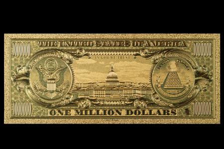 Souvenir Amerikaans goud bankbiljet $ 1 miljoen dollar geïsoleerd op een zwarte achtergrond
