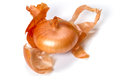 Bulb and onion peel isolated on white background Фото со стока