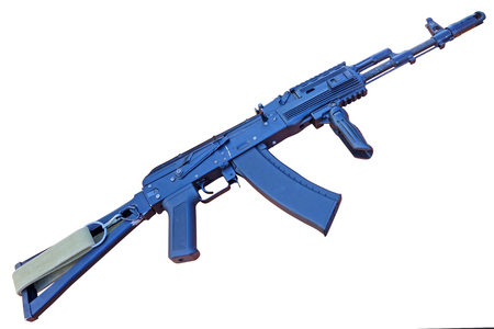 Kalashnikov, is a gas-operated, assault rifle, developed in the Soviet Union by Mikhail Kalashnikov. It is the originating firearm of the Kalashnikov rifle (or AK) family Stock Photo