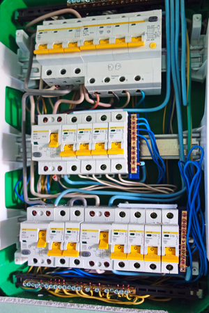 Electric board with circuit breakers. Circuit breaker used on items such as a residential iron, hot water heater, a kitchen oven, or an electric clothes dryer. 스톡 콘텐츠