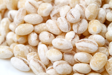 Pearl barley, or pearled barley, is barley that has been processed to remove its hull and bran. All barley must have its fibrous hull removed before it can be eaten; pearl barley is then polished to r