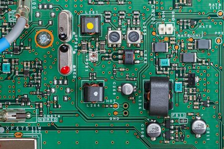 Electronic board with modern components of top view. Technological background