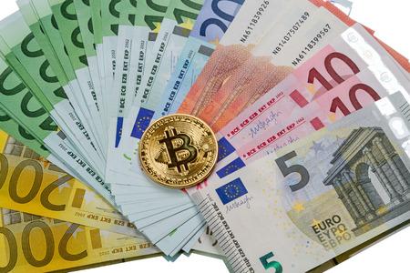 Gold coin bitcoin and various euro banknotes