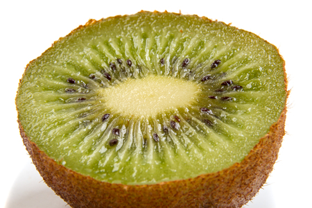 Half Kiwi closeup isolated on white background