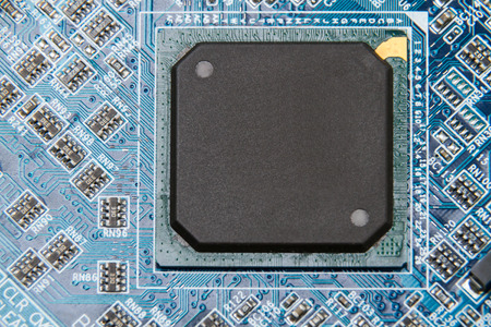 Large IC chip on printed circuit board. Copy space
