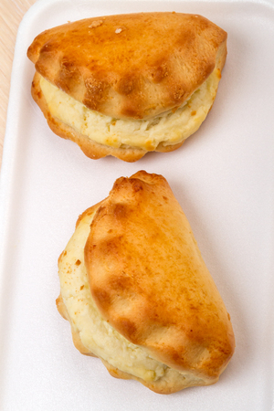 Two Cheese-filled bread (Khachapuri) view from the top