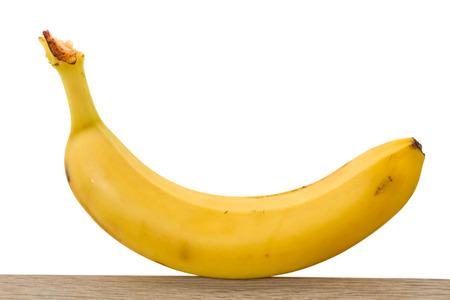 One ripe banana isolated on white background