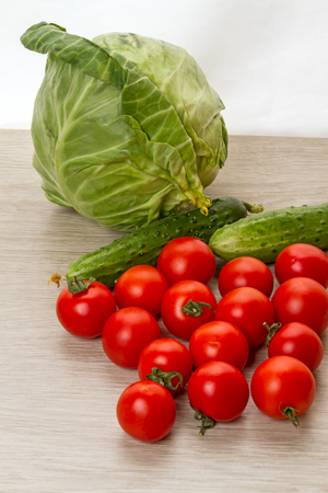 Fresh vegetables for salad on the table. Nature backgrounds