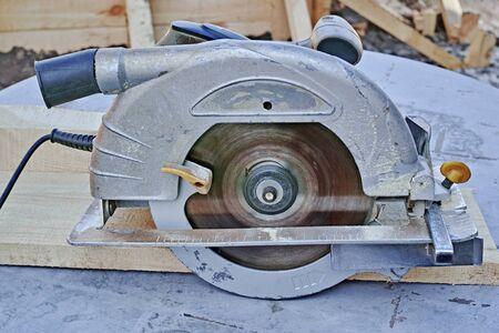 Working manual circular saw on the table