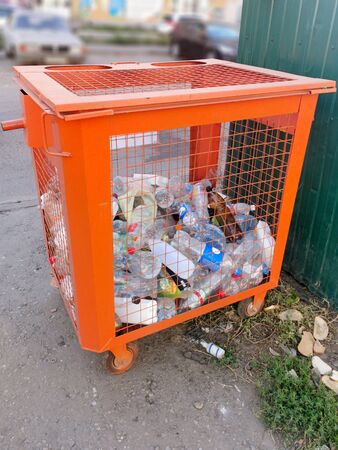 Container for collecting plastic dishes on a city street Stock Photo