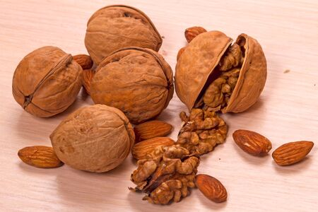 Ripe walnuts and shell on table. Food background 写真素材