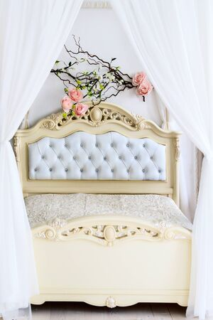 Large white bed behind the curtain for newly married couples 版權商用圖片