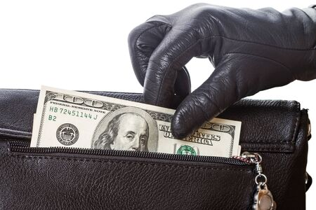 Hands in black gloves gets dollars from his pocket bags