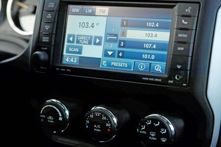 Monitor on the dashboard of the car in FM receiver