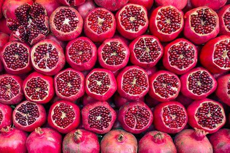 Background from heaps Ripe pomegranates Banco de Imagens