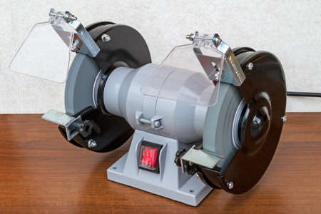A bench grinder is a benchtop type of grinding machine used to drive abrasive wheels. A pedestal grinder is a similar or larger version of grinder that is mounted on a pedestal, which may be bolted to the floor or may sit on rubber feet. These types of grinders are commonly used to hand grind various cutting tools and perform other rough grinding.