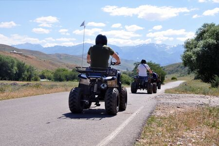 The ATV driving along the road