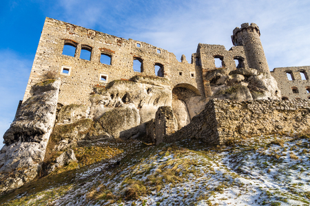 Ruins of the castle Ogrodzieniec in winter season. Poland