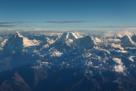 Peaks Himalaya Mountain, the highest mountain in the world from above. View from Yeti Airlines airplane, Nepal Stock Photo
