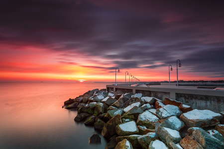 Sunrise with amazing colorful sky. Winter in Poland. Cold morning at Pier in Sopot.