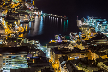 Panoramic view of the town of Ålesund by night from Aksla hill. It is a sea port, and is noted for its concentration of Art Nouveau architecture. Stock Photo