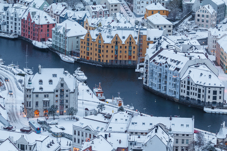 View of the town of Alesund during sunrise from Aksla hill. It is a sea port and is noted for its concentration of Art Nouveau architecture.