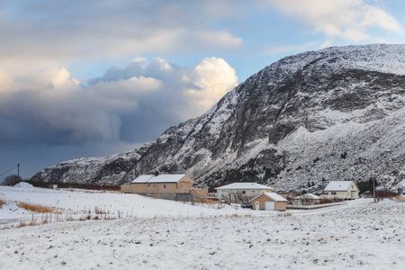 Houses on Godoya Island, near Alesund. Winter landscape. Norway