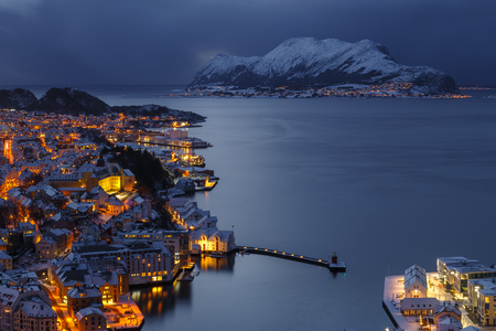 Panoramic view of the town of Alesund and Godoya Island by night from Aksla hill. It is a sea port, and is noted for its concentration of Art Nouveau architecture. Stock Photo