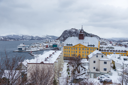 View of the town of Alesund from view point. Winter landscape. Alesund is a sea port and is noted for its concentration of Art Nouveau architecture. Stock Photo