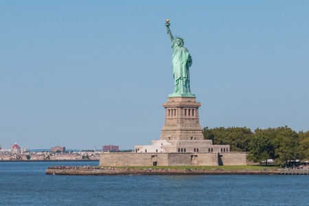 Statue of Liberty and panoramic view of Manhattan City skyline from the Staten Island public ferry. New York. USA.