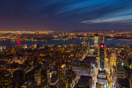 Aerial view of Manhattan at night, New York City in United States, America.