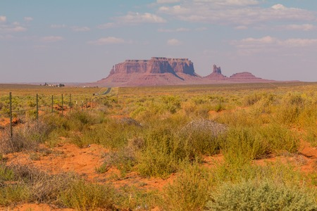 View on Merrick Butte, East and West Mitten Butte from road. Navajo Park of Monument Valley. Arizona, USA.