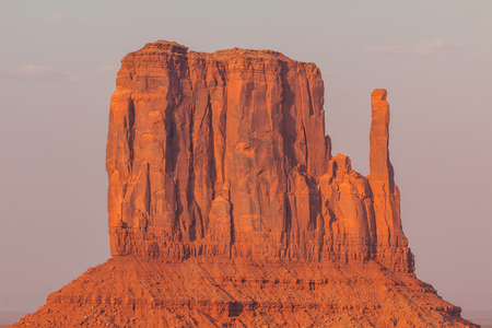 View on East Mitten Butte at sunrise. Navajo Park of Monument Valley. Arizona, USA. Stock Photo