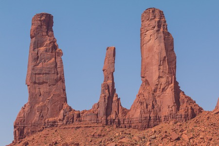 Three Sisters rock formation, view from John Fords Point. Navajo Park of Monument Valley. Stock Photo