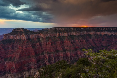 Sunset over the Grand Canyon, North Rim. The Grand Canyon is a river valley in the Colorado Plateau. Arizona, USA.