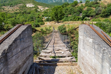 View of the old, destroyed bridge over the river Viosa, south Albania. Banco de Imagens