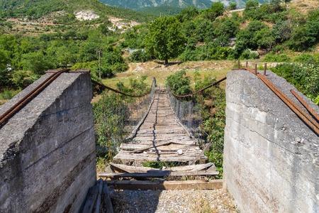 View of the old, destroyed bridge over the river Viosa, south Albania. Archivio Fotografico